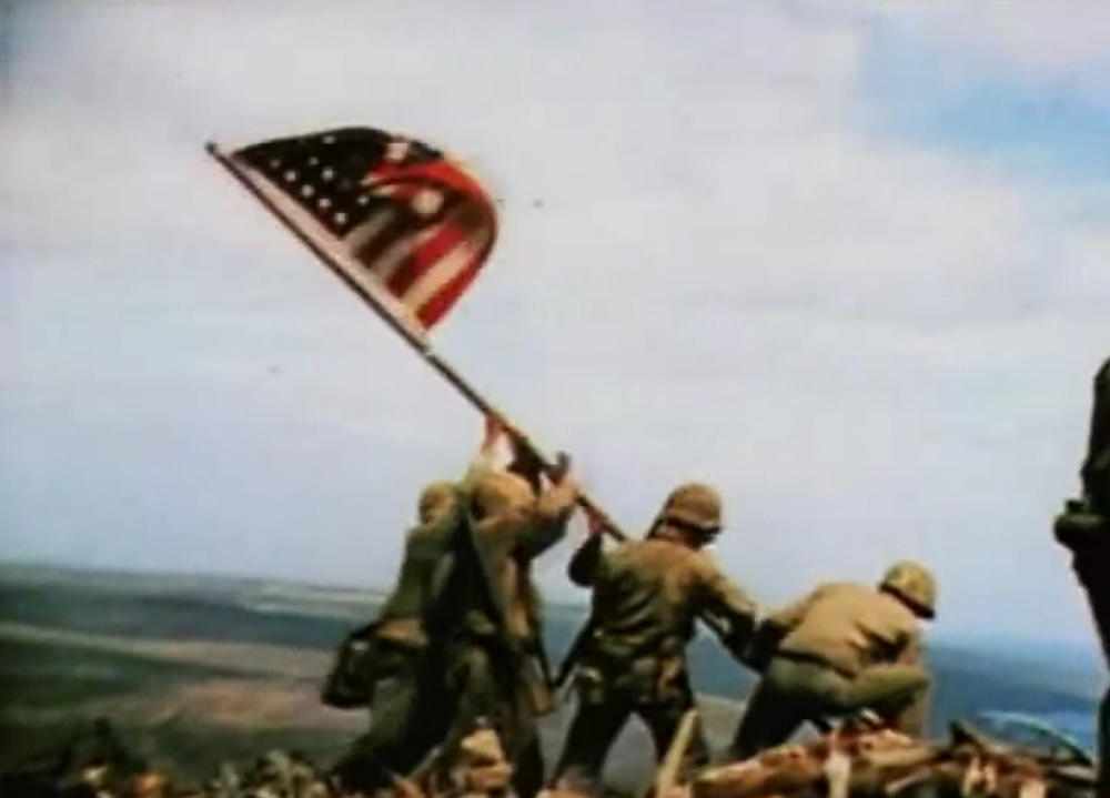 raising of the flag on iwo jima essay A us flag waves over iwo jima from the crest of mount suribachi in february 1945 dod photo an observer who spotted a japanese machine gun nest finds it on a map to convey the location information to fellow troops on iwo jima in february 1945.